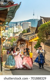 SEOUL - SOUTH KOREA - AUG 10, 2017 : A couple women wander through the traditional style houses of Bukchon Hanok Village in Seoul, South Korea.