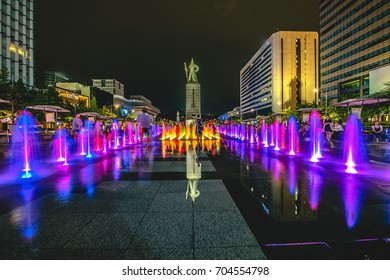 Seoul, South Korea: August 13, 2017, Colorful Fountains at Gwanghwamun Plaza with Statue of Admiral Yin Sun-Sin in Seoul City.Photo: August 13, 2017, in Seoul, South Korea
