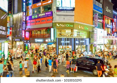 Seoul, South Korea - August 16, 2013: People shopping in Myeong-dong fashions district, current fashions and food culture are found in a jungle of tall buildings, banks and hotels