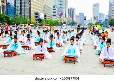 Seoul, South Korea - August 18, 2013: A group of people praying in Seoul Plaza, Gwanghwanum square in front of Seoul City Hall