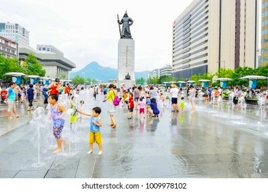 Seoul, South Korea - August 18, 2013: Children play in fountains at Seoul Plaza, Gwanghwanum square in front of Seoul City Hall