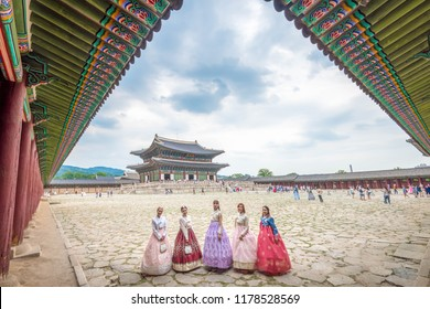 Seoul, South Korea - August 20, 2018: Korean lady in Hanbok or Korea gress and walk in an ancient town and Gyeongbokgung Palace in seoul, Seoul city, South Korea.