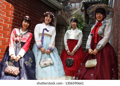 "SEOUL, SOUTH KOREA - August 20, 2018: beautiful Asian women wearing Korean traditional dress "" Hanbok "" during summer season at Hanok village in Seoul city, close to Gyeongju palace."
