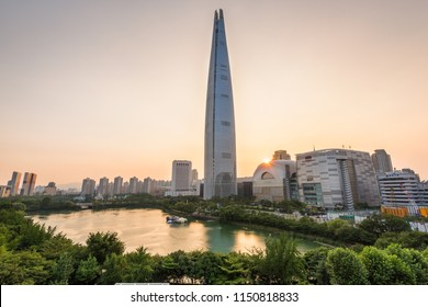 Seoul, South Korea - August, 2018: Sunset in Seokchon lake park and Lotte World Tower in Seoul city.