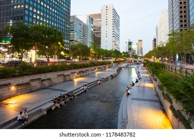 Seoul, South Korea - August 21, 2018: People relax on a warm summers evening in Cheonggyecheon. It is an urban river that flows west to east thru central Seoul in South Korea