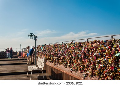 SEOUL, SOUTH KOREA - AUGUST 24: Couples clip padlocks to the observation deck at Namsan Tower as a sign of their commitment on August 24, 2013 in Seoul, South Korea.