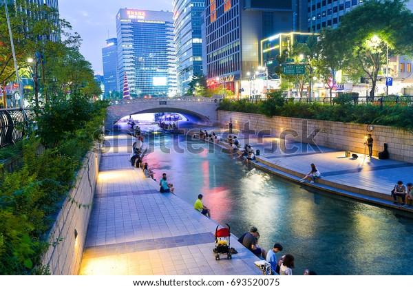Seoul, South Korea - August 7, 2017: See Cheonggyecheon Stream In Seoul people relax. Cheonggyecheon stream
