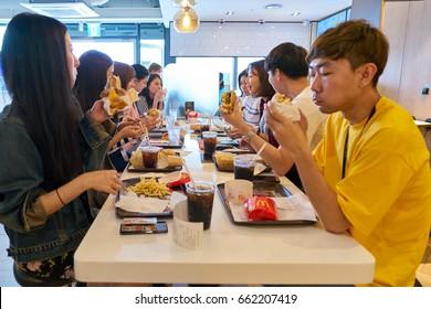 SEOUL, SOUTH KOREA - CIRCA MAY, 2017: people eat at McDonald's restaurant. McDonald's is an American hamburger and fast food restaurant chain.