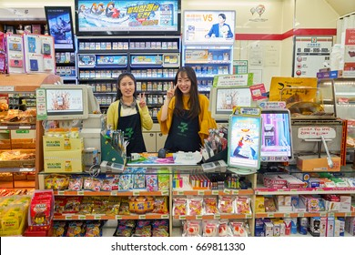 SEOUL, SOUTH KOREA - CIRCA MAY, 2017: indoor portrait of two women at at 7-Eleven convenience store. 7-Eleven is an international chain of convenience stores.