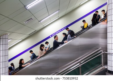 Seoul, South Korea - Circa May 2017: A view from the escalator at the metro station with crowd of people.