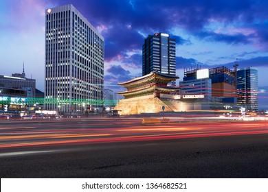 Seoul, South Korea cityscape and traffic Namdaemun Gate.