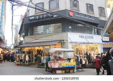 Seoul, South Korea - December 01, 2017: Street food stall in Hongdae street. This area is a famous shopping area for locals and tourists in Seoul, South Korea.