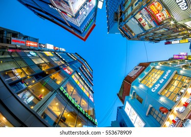 SEOUL, SOUTH KOREA - DECEMBER 11, 2016 : A vertical view of modern downtown skyscrapers of Myeongdong shopping street, premiere district for shopping in the city.