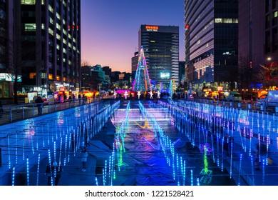 SEOUL, SOUTH KOREA - DECEMBER 16, 2017 : Cheonggyecheon Stream,People walking on Beautiful Christmas Light at night in Seoul, South Korea,