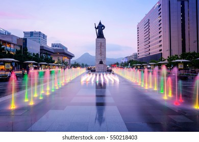 Seoul, South Korea - December 2016: Statue of Admiral Yi Sun-Shin  and colour floor water fountain at night, Gwanghwamun plaza.