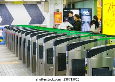 SEOUL, SOUTH KOREA - DECEMBER 21: Local Seoulites swipe their metro cards at Gangnam Station on December 21, 2014 in Seoul, South Korea.