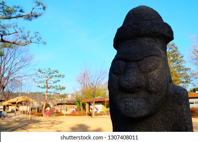 SEOUL, SOUTH KOREA - DECEMBER 26, 2018: Ancient Dol Hareubang Statue in front of The national folk museum of Korea where is a famous landmark of Seoul.