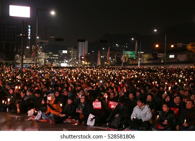 Seoul, South Korea - December 3, 2016: Hundreds of thousands of people gathered at a rally for 6th time with candle lights on their hands to call for the impeachment of President Park Geun-hye.