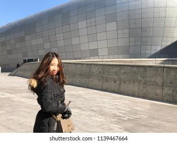 SEOUL, SOUTH KOREA - DECEMBER 31, 2017 : Unidentified woman standing inside Dongdaemun Design Plaza (DDP) in Seoul, South Korea on December 31,2017.
