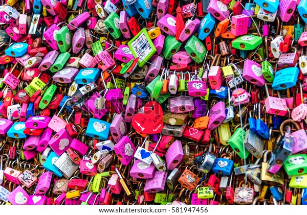 SEOUL, SOUTH KOREA - DECEMBER 31, 2016 - Padlocks attached to a fence of the Seoul Tower with promises of eternal love.