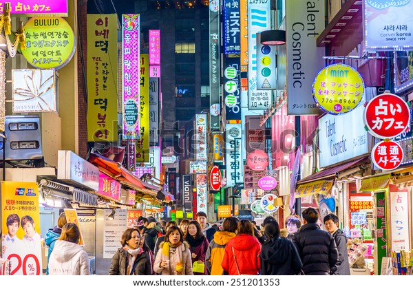 SEOUL, SOUTH KOREA - FEBRUARY 14, 2013: Crowds enjoy the Myeong-Dong district nightlife in Seoul.