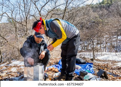 Seoul, South Korea, February 18th, 2017, Korean hikers cooking noodle at the valley of Bukhansan Mountain National park in Seoul, South Korea