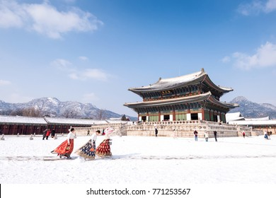 Seoul, South Korea - February, 2017: Gyeongbokgung palace in winter and girls in Hanbok clothes.