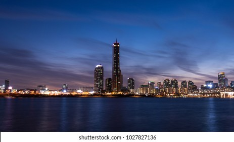 Seoul, South Korea - February, 2018: Yeouido district and Han river at night time in Seoul, South Korea.