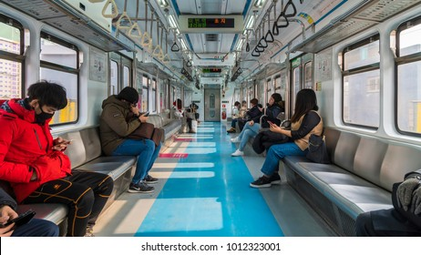 SEOUL, SOUTH KOREA - JANUARY 28, 2018 : People check their smartphones in a commuter train,Seoul Subway.South Korea