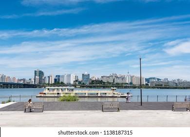 Seoul, South Korea - July, 2018: Seoul cityscape, view from Yeouido hangang park.
