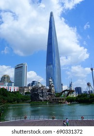 Seoul, South Korea, July 25, 2017, Seokchon lake and Lotte world tower in a clean sky which is one of the highest building and hot spots in Seoul, Korea
