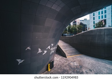 Seoul, South Korea - July 27, 2018: Front view of Dongdaemun Design Plaza (DDP). The newest and most iconic landmark of the Korean design industry with modern interior curve shape architectural.