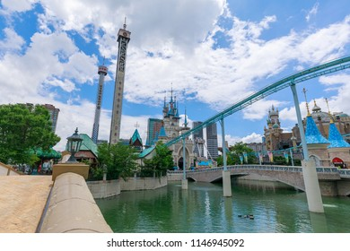 Seoul, South Korea - July 3, 2018 : Lotte World amusement theme park around Seokchon lake, a major tourist attraction in Seoul, South Korea.
