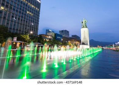 Seoul, South Korea - Jun 14, 2106: Statue of Admiral Yi Sun-Sin and colour floor water fountain at night, Gwanghwamun plaza.