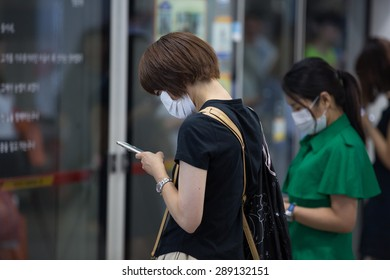 SEOUL, SOUTH KOREA - JUN 19, 2015: Passengers on the subway wear masks to protect against the deadly MERS (Middle East Respiratory Syndrome) virus outbreak in Korea.