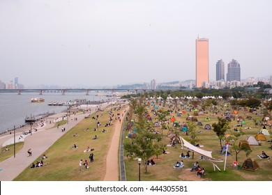 Seoul, South Korea: Late afternoon at Yeouido Hangang Park and Han river, people are relaxing weekend.