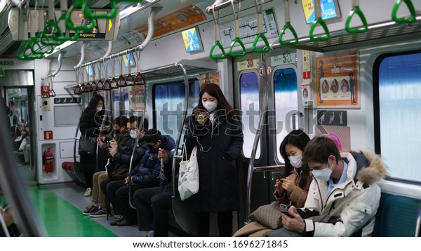 Seoul, South Korea - March 04 2020: Coronavirus outbreak in South Korea. Daily commuters still use public transit.