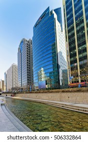 Seoul, South Korea - March 11, 2016: Urban park and Cheonggyecheon public recreation walkway, in Seoul, South Korea. People passing by