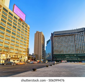 Seoul, South Korea - March 11, 2016: Skyscrapers in Seoul Plaza in Jung district in Seoul, South Korea. Golden light at sunset. People on the background