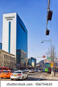 Seoul, South Korea - March 11, 2016: Much car traffic and Modern skyscrapers in Jung district in Seoul, South Korea. People on the background