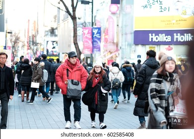 SEOUL, SOUTH KOREA - March 12 2017 : people wander in the walking street of the Myeong-dong shopping cosmetic and entertainment district at night in winter season