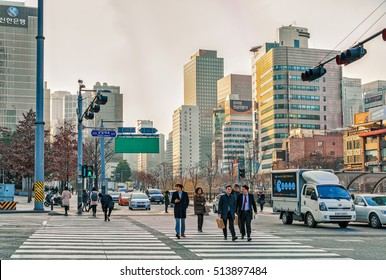 Seoul, South Korea - March 14, 2016: Pedestrians on the road and Skyscrapers of Jongno district in Seoul, South Korea. People on the background