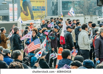 SEOUL, South Korea, March 18,2017: Protesters gather at a rally in central Seoul to demonstrate against the impeachment of Park Gun Hey