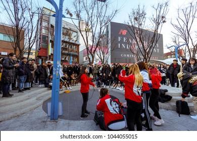 Seoul, South Korea - March 2, 2018 : Hongdae (Hongik University) shopping street, Unidentified musician shows tourist on the street.