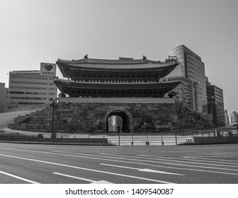 Seoul, South Korea - March 2018: Namdaemun gate, buildings background on a beautiful day. Black and white.