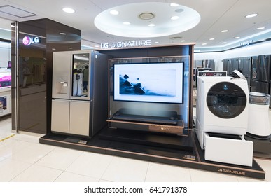 SEOUL, SOUTH KOREA - MARCH 26, 2017: The LG Signature refrigerator, OLED TV, washing machine and air purifier at a store in the Hyundai IPark Shopping Mall.