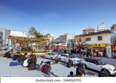 Seoul, South Korea - March 3, 2018 : Hongdae (Hongik University) shopping street. Hongdae is a shopping cultural street for young people in Seoul.