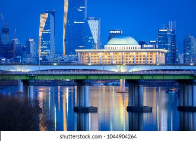 Seoul, South Korea - March 3, 2018 : Night view of Korea National Assembly Hall with Han river in Seoul city, South Korea
