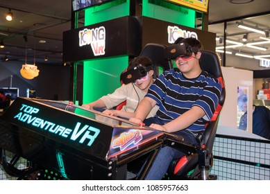 Seoul, South Korea - May 05, 2018 : They wear headsets and experience roller coasters at the VR arcade of Lotte World Tower in Seoul.