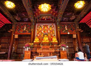 SEOUL, SOUTH KOREA - MAY 10: Buddhists pray and meditate inside Bongeunsa Temple on May 10, 2014 in Seoul, South Korea.